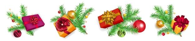 Ensemble de branches d'arbres de noël avec des boules, des coffrets cadeaux et des morceaux de serpentine sur fond blanc