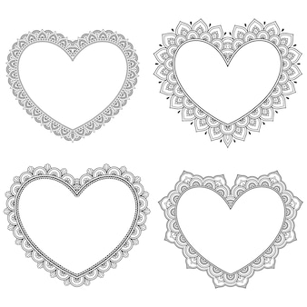 Ensemble de cadre décoratif avec des fleurs en forme de coeur dans le style mehndi.