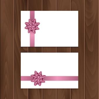 Ensemble de cartes-cadeaux avec noeud et ruban réalistes.