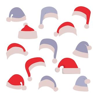 Ensemble de chapeaux de père noël rouge et bleu isolé