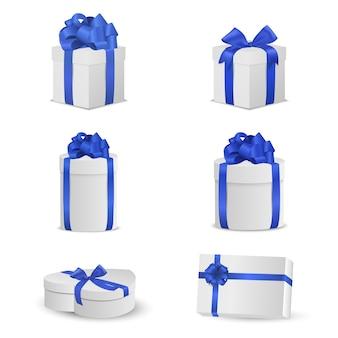 Ensemble de coffrets cadeaux blancs avec des arcs bleus et des rubans.