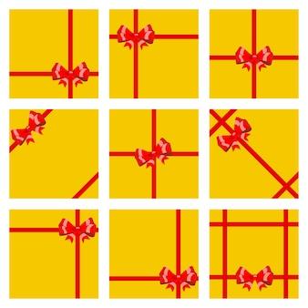 Ensemble de coffrets cadeaux jaunes, attachés avec des rubans rouges et des arcs. vue de dessus. plat