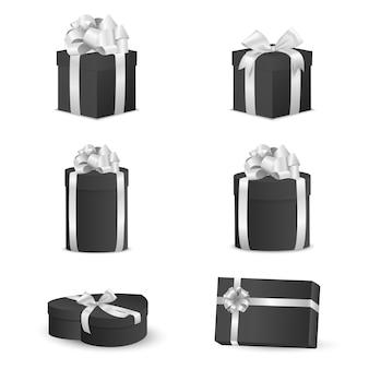 Ensemble de coffrets cadeaux noirs avec des arcs blancs et des rubans.