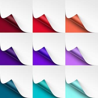 Ensemble de coins colorés recourbés de papier blanc avec ombre