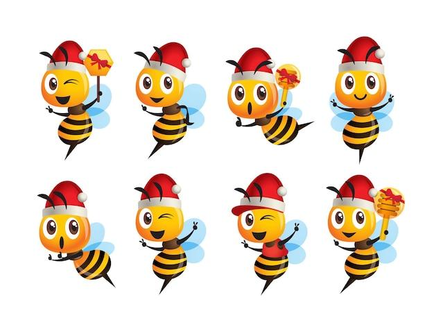Ensemble de collection d'abeilles mignonnes de dessin animé portant un chapeau de noël avec une pose différente