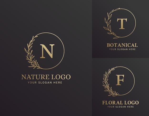 Ensemble de conception d'illustration de logo botanique floral dessiné à la main élégant noir et or pour la marque biologique naturelle de beauté