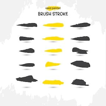 Ensemble de coups de pinceau aquarelle à la main noir et jaune
