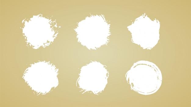 Ensemble de coups de pinceau, coups de sircle de pinceau grunge encre blanche