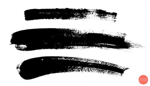 Ensemble de coups de pinceau dessinés à la main, taches. ensemble d'éléments de conception monochrome.