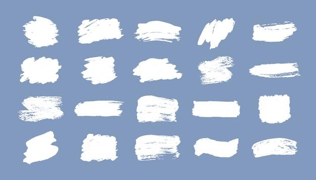 Ensemble de coups de pinceau. éléments de conception grunge. peinture dorée, encre, pinceaux, lignes, grungy. boîtes artistiques sales, cadres. lignes d'or isolées. illustration d'art texturé scintillant abstrait or.