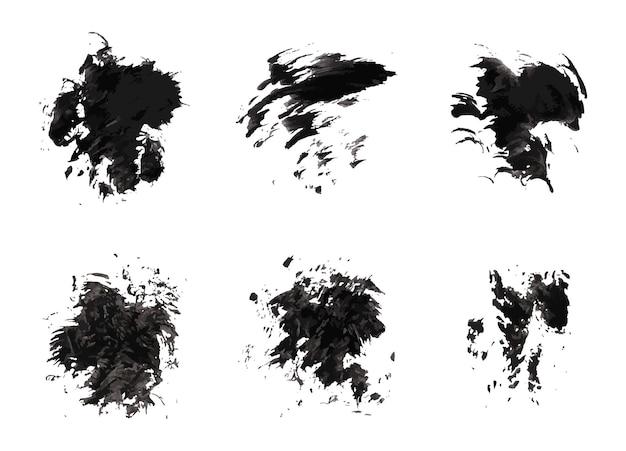 Ensemble de coups de pinceaux grunge coups de peinture avec un pinceau sec. taches d'encre abstraites