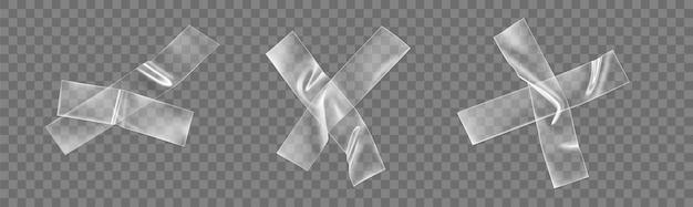 Ensemble de croix de ruban en plastique adhésif transparent isolé sur transparent