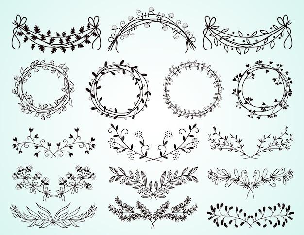 Ensemble de délicates bordures et couronnes florales et feuillées dessinées à la main en noir et blanc pour les éléments de conception décorative sur les cartes de voeux