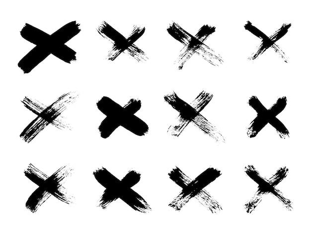 Ensemble dessiné à la main de coups de pinceau croisés x collection de rayures noires signe de croix symbole graphique vecteur