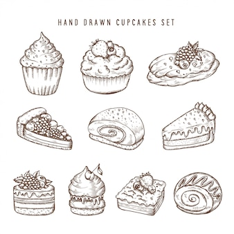 Ensemble dessiné à la main de cupcakes et de produits de boulangerie