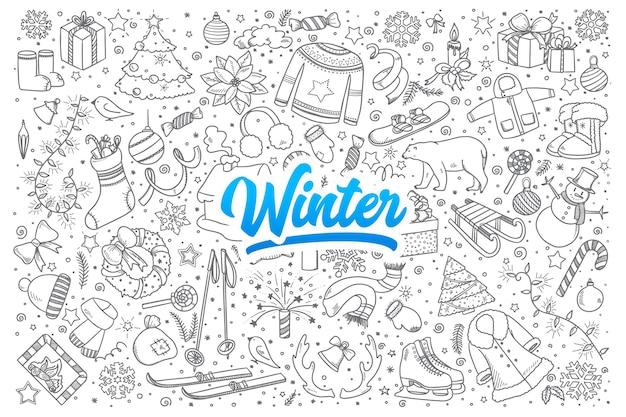 Ensemble dessiné à la main de griffonnages d'hiver avec lettrage bleu
