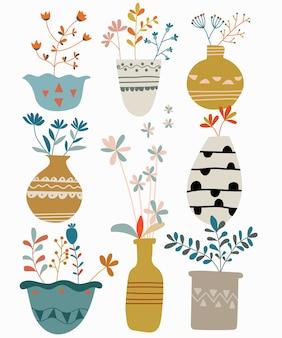 Ensemble dessiné main de vase de fleurs colorées isolé sur fond blanc.