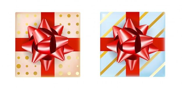 Ensemble de deux coffret cadeau, couleur beige et bleu avec un ruban rouge et un noeud. le cadeau réaliste de la collection présente le dessus de la vue.