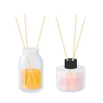 Ensemble de diffuseurs d'arômes. deux pots en verre avec des bâtons d'arôme.