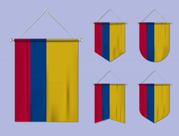 Ensemble de drapeaux suspendus colombie avec texture textile. formes de diversité du pays du pavillon national. fanion de modèle vertical