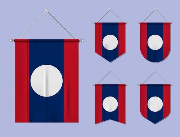 Ensemble de drapeaux suspendus laos avec texture textile. formes de diversité du pays du pavillon national. fanion de modèle vertical