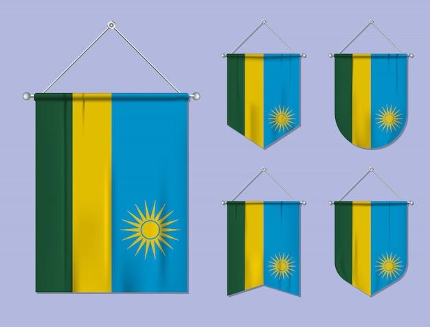 Ensemble de drapeaux suspendus rwanda avec texture textile. formes de diversité du pays du pavillon national. fanion de modèle vertical