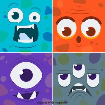 Ensemble de drôles de monstres visages colorés