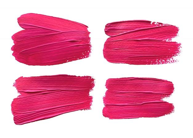 Ensemble d'effet de coups de pinceau rose isolé.