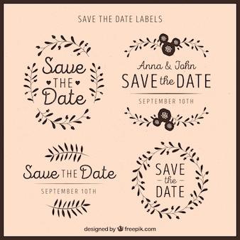 Ensemble élégant d'étiquettes de mariage avec des feuilles
