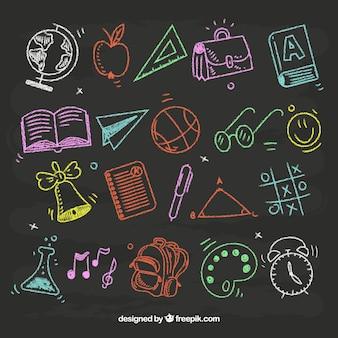 Ensemble d'éléments de l'école dans le style de tableau noir