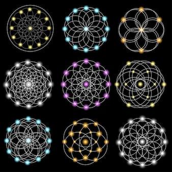 Ensemble d'éléments géométriques abstraits et formes sur fond noir.