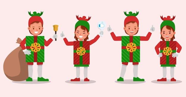 Ensemble d'enfants garçon et fille portant le caractère de costumes de boîte-cadeau de noël