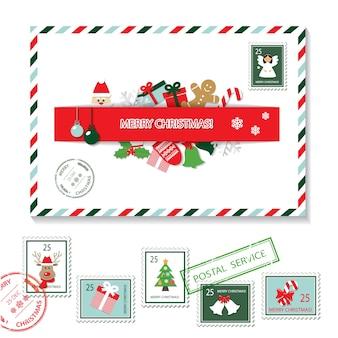 Ensemble enveloppe de noël et timbres postaux.