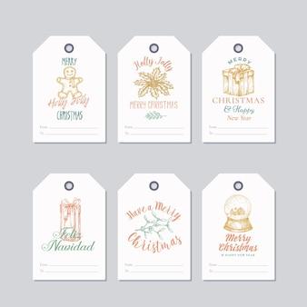 Ensemble d'étiquettes-cadeaux ou de modèles d'étiquettes de couleur pastel prêts à l'emploi de noël et du nouvel an. biscuit dessiné à la main, gui, boule de neige, houx et croquis de boîte-cadeau avec typographie rétro. isolé.