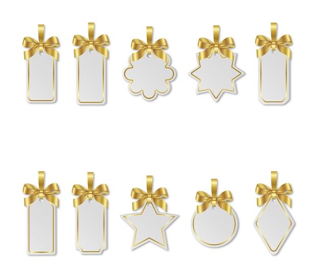 Ensemble d'étiquettes de prix blanches de noël avec des arcs en or