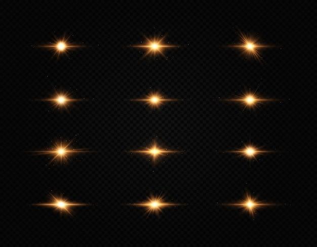 Ensemble d'étoiles brillantes, la lumière brillante dorée explose sur un fond transparent