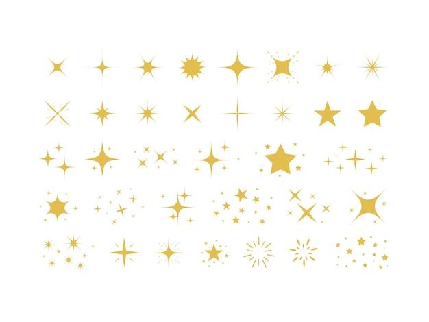 Ensemble d'étoiles d'or et d'étincelles isolées sur fond blanc symboles d'étincelles étincelles et étoiles