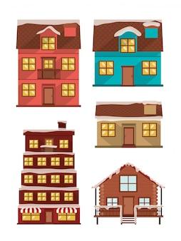 Ensemble de façades de maisons avec de la neige