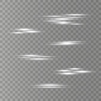 Ensemble de flashs, lumières et étincelles sur un fond transparent. rayons de lumière brillants. des lignes éclatantes.
