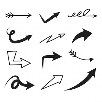 Ensemble de flèche doodle sur fond blanc