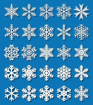 Ensemble de flocons de neige blancs avec des ombres sur bleu.