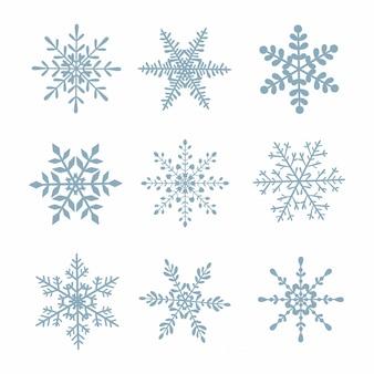 Ensemble de flocons de neige sur fond blanc isolé.