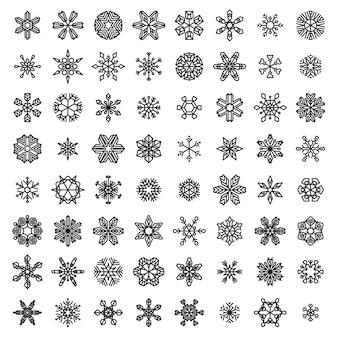 Ensemble de flocons de neige linéaires. flocons de neige décrits en noir isolés sur fond blanc.