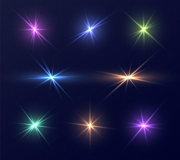 Ensemble de fusées éclairantes colorées, reflets brillants avec des rayons. collection d'étincelles magiques
