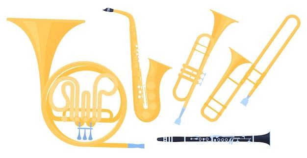 Ensemble d'instruments de musique à vent. saxophone, trompette, cor, clarinette sur fond blanc. consommation