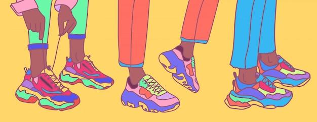 Ensemble de jambes brunes féminines ou masculines dans les baskets. chaussures de sport lumineuses et fraîches. illustration de mode tendance colorée dessinée à la main.