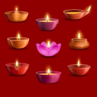 Ensemble de lampes diwali diya du festival de la lumière indienne deepavali et de la conception de vacances de religion hindoue. lampes à huile avec flammes de feu brûlant, coupes en argile avec motif rangoli de fleurs paisley, pétales de fleurs
