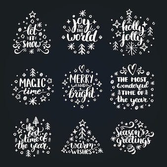 Ensemble de lettrage de main de nouvel an sur fond noir. illustrations de dessin à la craie de noël.