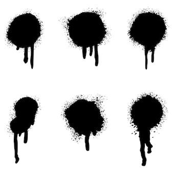 Ensemble de lignes peintes à la bombe graffiti et points de grunge isolés sur fond blanc.