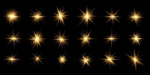 Ensemble de lumière rougeoyante jaune explose sur un fond transparent particules de poussière magique étincelante. l'étoile éclate d'étincelles. paillettes d'or bright star. soleil brillant transparent, flash brillant